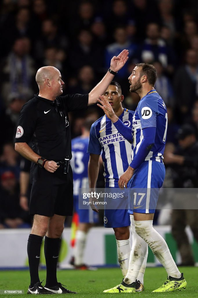 Referee Lee Mason talks to Glenn Murray of Brighton and Hove Albion during the Premier League match between Brighton and Hove Albion and Stoke City at Amex Stadium on November 20, 2017 in Brighton, England.