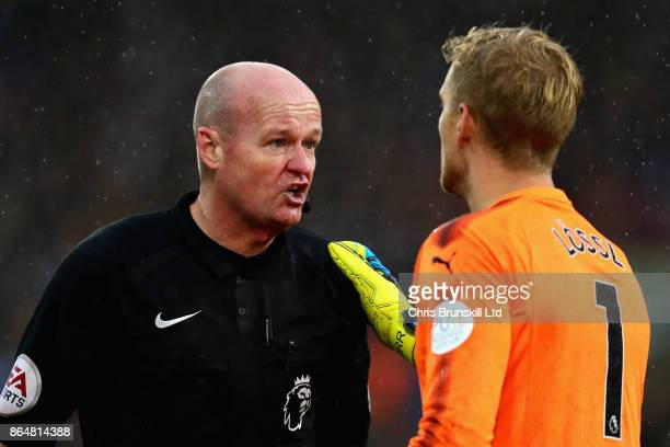 Referee Lee Mason talks with Jonas Lossl of Huddersfield Town during the Premier League match between Huddersfield Town and Manchester United at John...