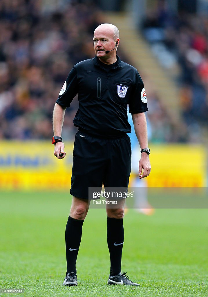 Referee Lee Mason watches on during the Barclays Premier League match between Hull City and Manchester City at the KC Stadium on March 15, 2014 in Hull, England.