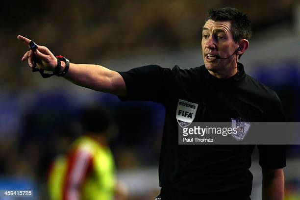 Referee Lee Probert gestures during the Barclays Premier League match between Everton and Sunderland at Goodison Park on December 26 2013 in...