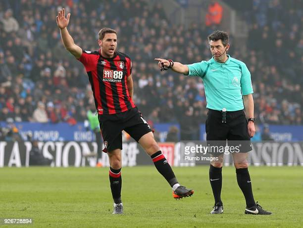 Referee Lee Probert points to the penalty spot after Marc Albrighton of Leicester City brings down Joshua King of Bournemouth in the box during the...