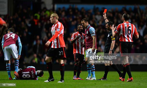 Referee Lee Probert shows the red card to send off Sunderland's Beninese midfielder Stephane Sessegnon after a challenge on Aston Villa's French...