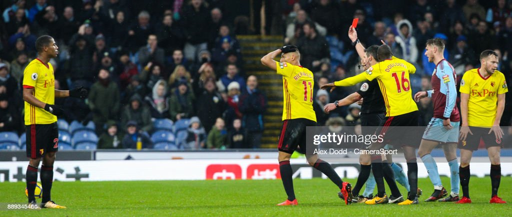 Referee Lee Probert shows Watford's Marvin Zeegelaar (left) the red card for a foul on Burnley's Steven Defour during the Premier League match between Burnley and Watford at Turf Moor on December 9, 2017 in Burnley, England.