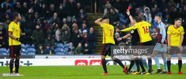 Referee Lee Probert shows Watford's Marvin Zeegelaar the red card for a foul on Burnley's Steven Defour during the Premier League match between...