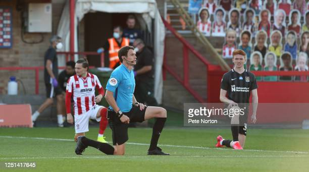Referee Leigh Doughty takes a knee prior to kick off during the Sky Bet League Two Play Off Semifinal 2nd Leg match between Cheltenham Town and...