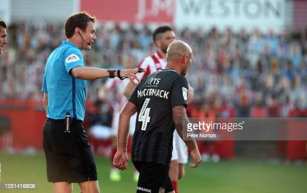 Referee Leigh Doughty talks to Alan McCormack of Northampton Town during the Sky Bet League Two Play Off Semifinal 2nd Leg match between Cheltenham...
