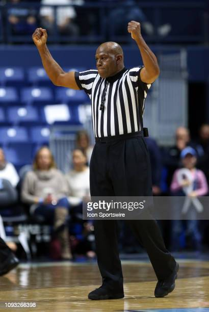 Referee Leslie Jones calls a blocking foul during a college basketball game between Saint Louis Billikens and Rhode Island Rams on February 2 at the...