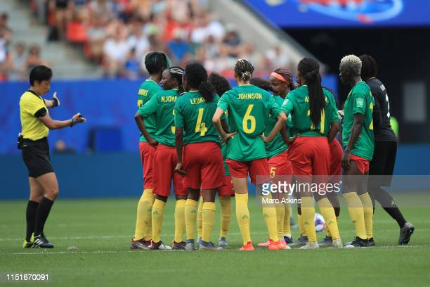 Referee Liang Qin invites the Cameroon players to play on as they protest after a VAR decision goes against them during the 2019 FIFA Women's World...