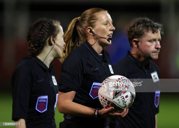Referee Lisa Benn with assistants Stuart Kane and Ceri Williams during the Barclays FA Women's Super League match between Birmingham City Women and...