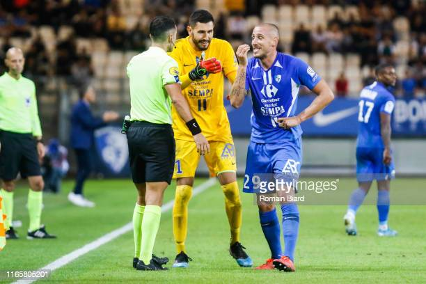 Referee Lissorgue Romain and Gibaud Pierre of Grenoble and Maubleu Brice of Grenoble during the Ligue 2 match between Grenoble and Lens at Stade des...
