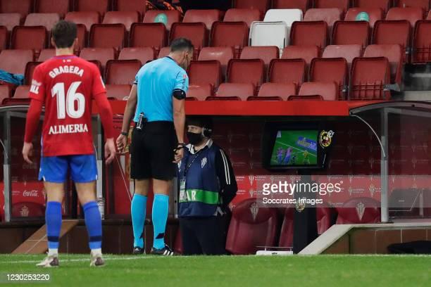 Referee looking at the VAR during the La Liga SmartBank match between Sporting Gijon v Leganes at the El Molinon stadium on December 21, 2020 in...