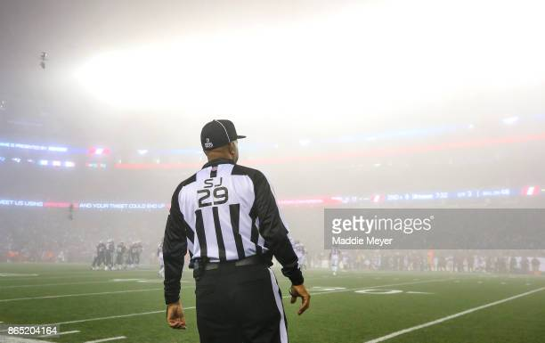A referee looks on as fog falls during a game between the New England Patriots and the Atlanta Falcons at Gillette Stadium on October 22 2017 in...