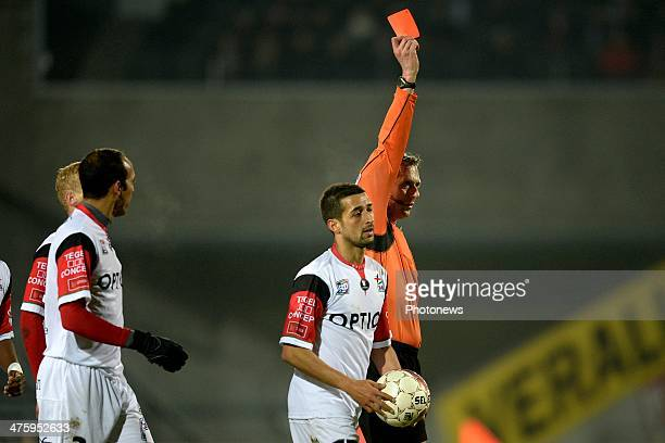 referee Luc Wouters shows a red card to Evariste Ngolok of OH Leuven during the Jupiler League match between K Lierse SK and Oud Heverlee Leuven on...