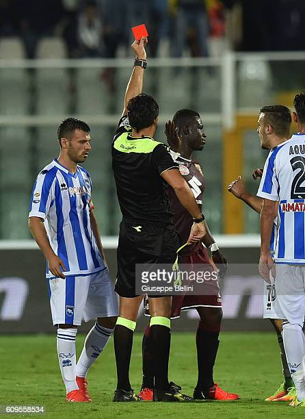 Referee Luca Banti shows the red card to Afriyie Acquah of FC Torino during the Serie A match between Pescara Calcio and FC Torino at Adriatico...