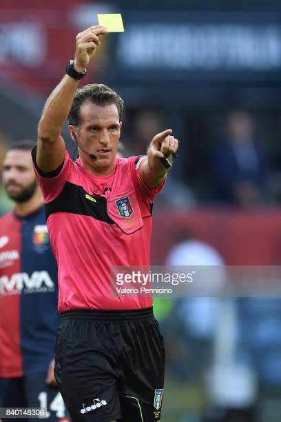 Referee Luca Banti shows the yellow card during the Serie A match between Genoa CFC and Juventus at Stadio Luigi Ferraris on August 26 2017 in Genoa...