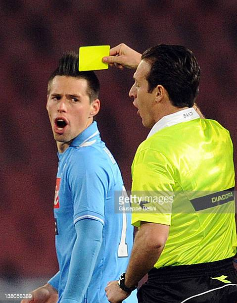 Referee Luca Banti shows the yellow card to Marek Hamsik of Napoli during the Serie A match between SSC Napoli and AC Cesena at Stadio San Paolo on...