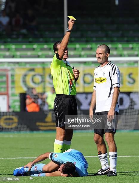 Referee Luca Banti shows the yellow card to Maurizio Lauro of Cesena during the Serie A match between AC Cesena and AC Chievo Verona at Dino Manuzzi...