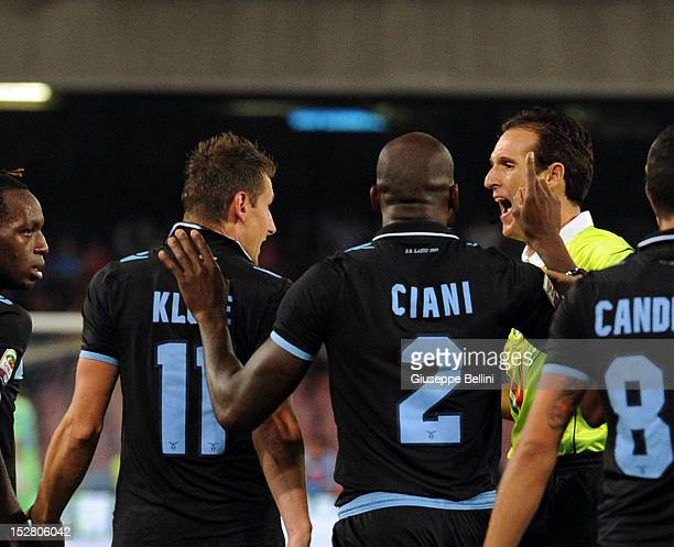 Referee Luca Banti speaks with Miroslav Klose of Lazio during the Serie A match between SSC Napoli and SS Lazio at Stadio San Paolo on September 26...
