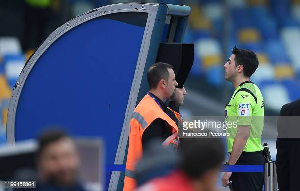 Referee Luca Massimi checks a play on the VAR during the Coppa Italia match between SSC Napoli and Perugia on January 14 2020 in Naples Italy