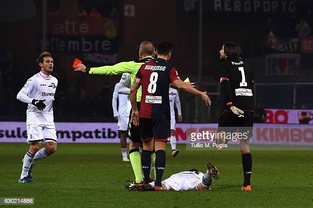 Referee Luca Pairetto shows a red card to Mattia Perin goalkeeper of Genoa during the Serie A match between Genoa CFC and US Citta di Palermo at...