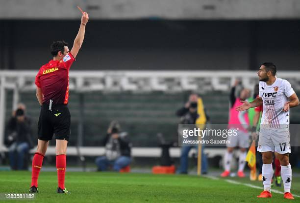 Referee Luca Sacchi shows the red card to Gianluca Caprari of Benevento Calcio during the Serie A match between Hellas Verona FC and Benevento Calcio...
