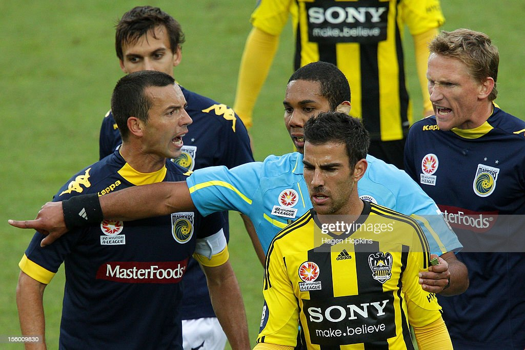 Referee Lucien Laverdure makes a call while John Hutchinson (L) and Daniel McBreen of the Mariners show their frustration during the round six A-League match between the Wellington Phoenix and the Central Coast Mariners at Westpac Stadium on November 11, 2012 in Wellington, New Zealand.