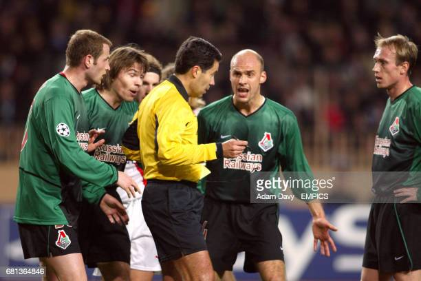 Referee Lucilio Cardoso Cortez Batista is at the centre the action after sending of Lokomotiv Moscow's Dmitri Loskov