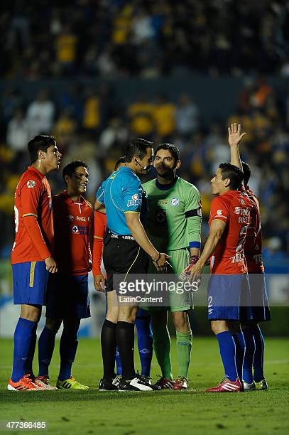 Referee Luis Enrique Santander argues with players of Cruz Azul during a match between Tigres UANL and Cruz Azul as part of the 10th round Clausura...