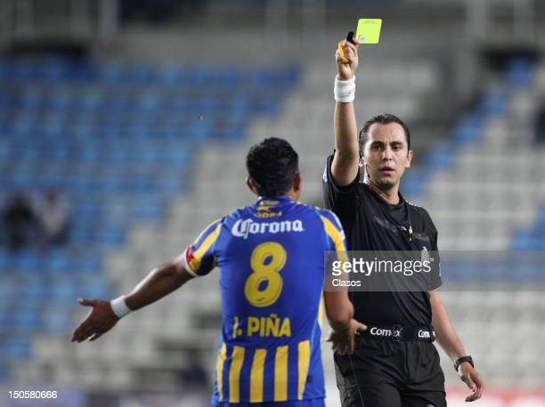 Referee Luis Enrique Santander shows a yellow card during a match between Pachuca and La Piedad as part of the Copa MX 2012 on August 21 2012 in...