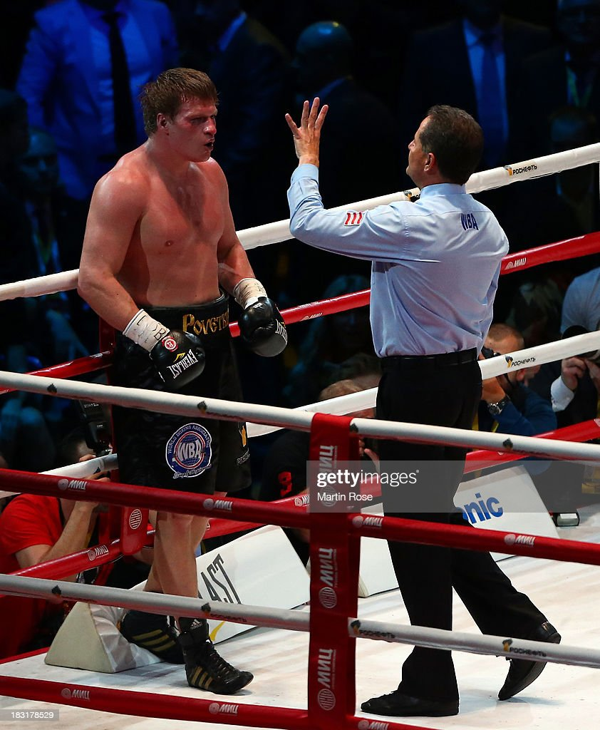 Referee Luis Pabon of Costa Rica counts to Alexander Povetkin of Russia during their WBO, WBA, IBF and IBO heavy weight title fight between Wladimir Klitschko and Alexander Povetkin of Russia at Olimpiyskiy Arena on October 5, 2013 in Moscow, Russia.