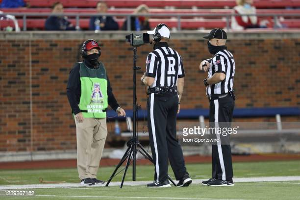 Referee Luke Richmond reviews a replay during the game between SMU and Cincinnati on October 24, 2020 at Gerald J. Ford Stadium in Dallas, TX.