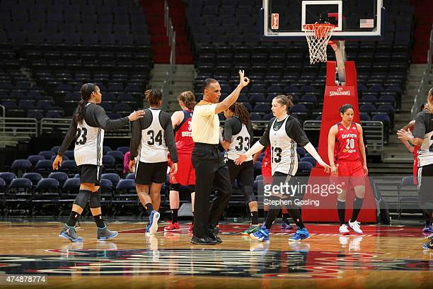 A WNBA Referee makes a call during a game between the Minnesota Lynx and Washington Mystics during an Analytic Scrimmage at the Verizon Center on May...