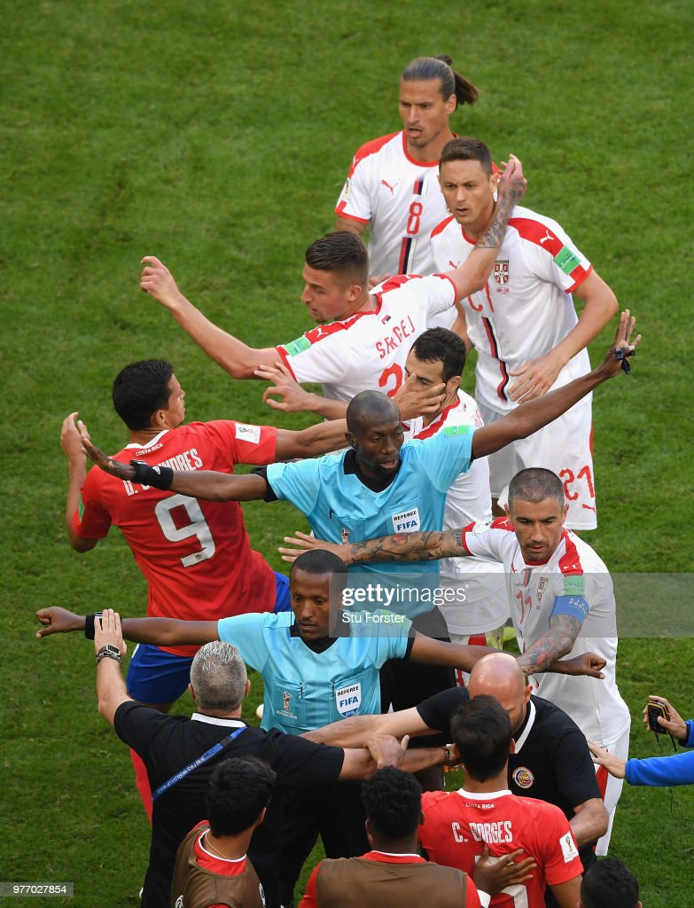Referee Malang Diedhiou (c) steps in to seperate Serbia player Nemanja Matic (top right) from the Costa Rica bench during the 2018 FIFA World Cup Russia group E match between Costa Rica and Serbia at Samara Arena on June 17, 2018 in Samara, Russia.