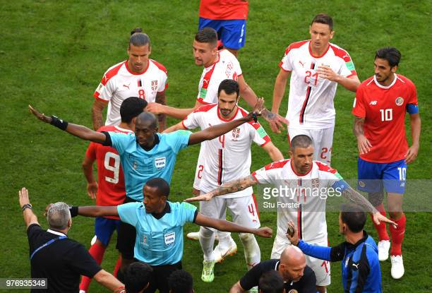 referee Malang Diedhiou tries to divide players from Serbia and Costa Rica during the 2018 FIFA World Cup Russia group E match between Costa Rica and...