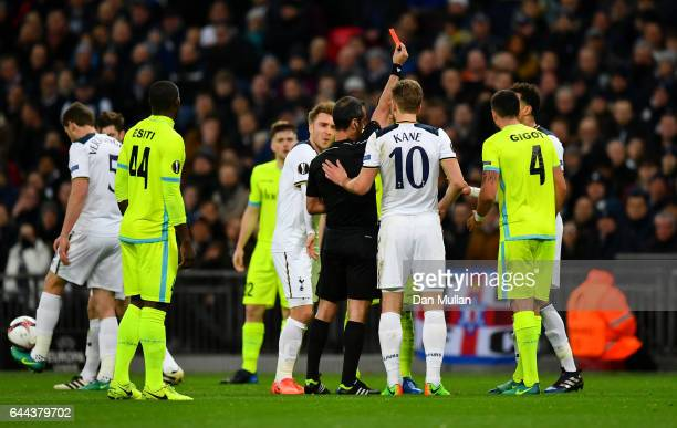 Referee Manuel De Sousa shows a red card to Dele Alli of Tottenham Hotspur as he is sent off during the UEFA Europa League Round of 32 second leg...