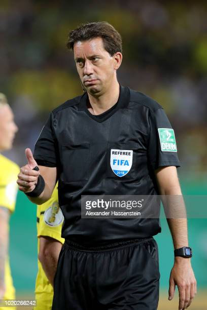 Referee Manuel Graefe reacts during the DFB Cup first round match between SpVgg Greuther Fuerth and BVB Borussia Dortmund at Sportpark Ronhof Thomas...