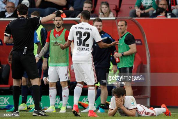 Referee Manuel Graefe shows the red card to Romain Bregerie of Ingolstadt during the Bundesliga match between FC Ingolstadt 04 and SV Darmstadt 98 at...