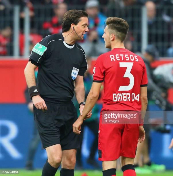 Referee Manuel Graefe speaks with Panagiotis Retsos of Leverkusen during the Bundesliga match between Bayer 04 Leverkusen and 1 FC Koeln at BayArena...