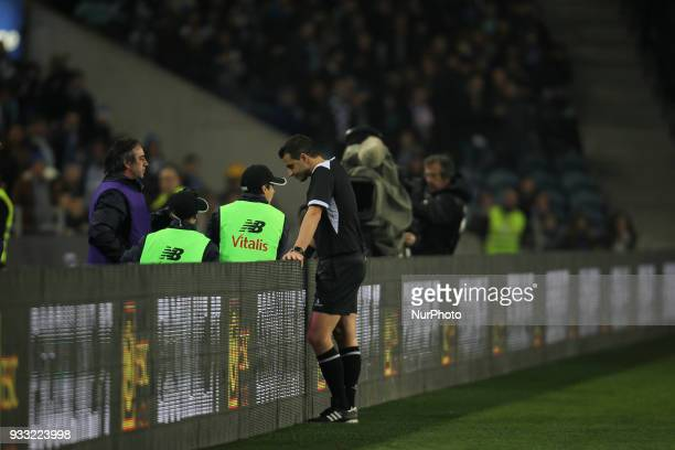 Referee Manuel Oliveira confere VAR 'video referee' during the Premier League 2017/18 match between FC Porto v Boavista FC at Dragao Stadium in Porto...