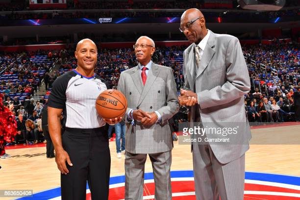 Referee Marc Davis poses for a photo with Dave Bing and Bob Lanier before the game between the Charlotte Hornets and the Detroit Pistons on October...