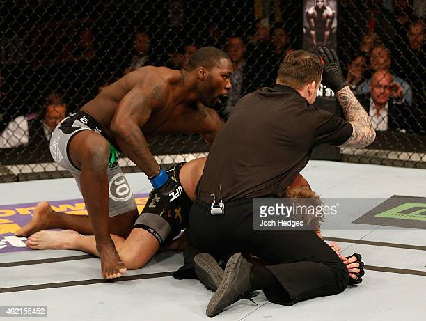 Referee Marc Goddard moves in to stop the bout as Anthony Johnson of the United States defeats Alexander Gustafsson of Sweden by TKO in their light...