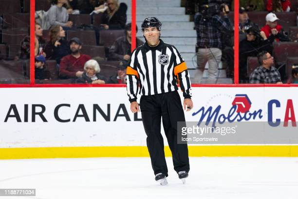 Referee Marc Joannette waits for a face-off during third period National Hockey League action between the Columbus Blue Jackets and Ottawa Senators...