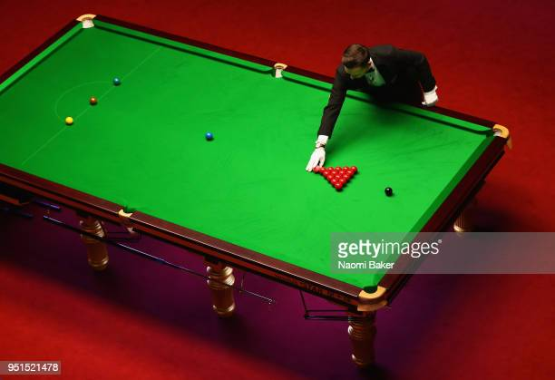 Referee Marcel Eckardt places the pink ball during day six of the World Snooker Championship at Crucible Theatre on April 26, 2018 in Sheffield,...