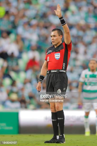 Referee Marco Antonio Ortiz gestures during the 10th round match between Santos Laguna and Monterey as part of the Torneo Grita Mexico A21 Liga MX at...