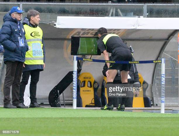 Referee Marco Di Bello looks VAR during the serie A match between Hellas Verona FC and Atalanta BC at Stadio Marc'Antonio Bentegodi on March 18 2018...