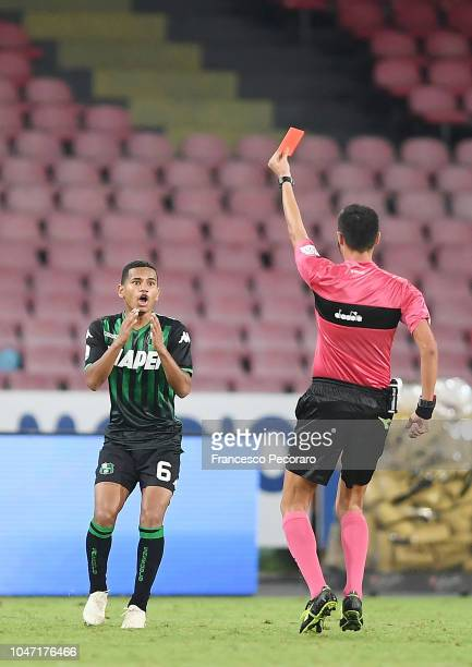 Referee Marco Di Bello shows the red card to Rogerio of US Sassuolo during the Serie A match between SSC Napoli and US Sassuolo at Stadio San Paolo...