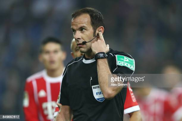 Referee Marco Fritz checks with the video referee to later decide for a penalty during the Bundesliga match between FC Schalke 04 and FC Bayern...