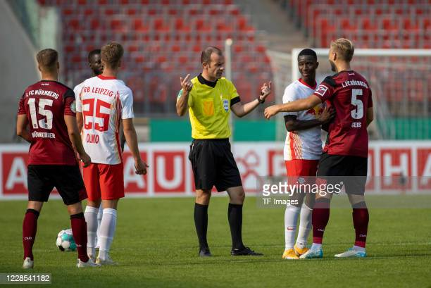 referee Marco Fritz Dani Olmo of RB Leipzig and Johannes Geis of 1FC Nuernberg during the DFB Cup first round match between 1 FC Nuernberg and RB...