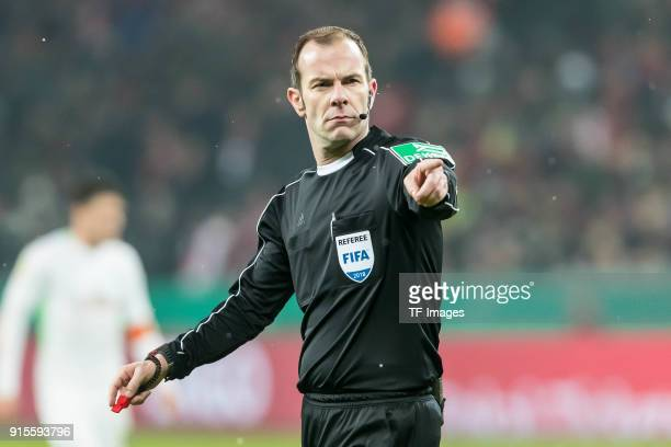 Referee Marco Fritz gestures during the DFB Cup match between Bayer Leverkusen and Werder Bremen at BayArena on February 6 2018 in Leverkusen Germany