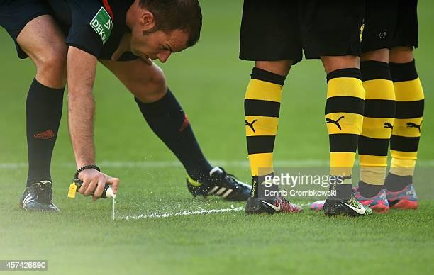 Referee Marco Fritz uses vanashing spray during the Bundesliga match between 1. FC Koeln and Borussia Dortmund at RheinEnergieStadion on October 18,...